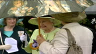 Queen and Prince Philip visit organic dairy products factory ENGLAND Somerset Queen Elizabeth II along Queen chatting to woman Queen getting in car