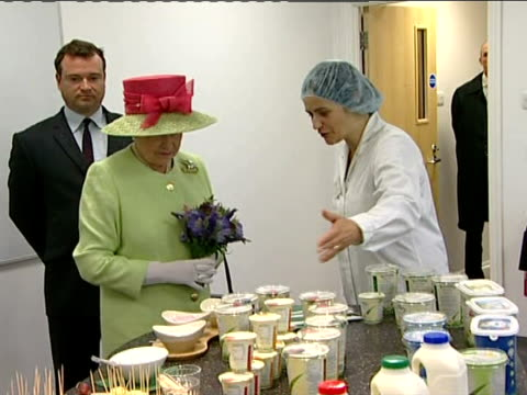 Queen and Prince Philip visit organic dairy products factory ENGLAND Somerset INT Queen Elizabeth II meeting people whilst touring factory / Queen...