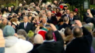 Queen and Royal Family attend Sandringham church service on Christmas Day arrivals ENGLAND Norfolk Sandringham EXT Crowds lining the route to church...