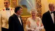 Queen at state banquet in Turkey INT Ankara President Abdullah Gul and his wife Hayrunisa Gul the Queen and Prince Philip along into room then posing...