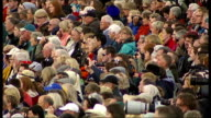 Queen attends Braemar highland games Audience watching games / Royals watch games under sheltered area