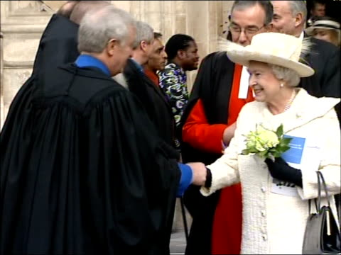 Queen attends Commonwealth Day Service at Westminster Abbey EXT Queen towards with Dean John Hall as exits Abbey and presented with flowers from...