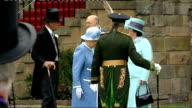 Queen attends Holyroodhouse garden party SCOTLAND Edinburgh Holyroodhouse EXT GVs Queen Elizabeth II and Prince Philip Duke of Edinburgh down steps...