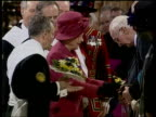 Queen attends Royal Maundy Service YTV Lincoln Cathedral Queen Elizabeth II in pink hat and coat distributing Maundy Money to pensioners TGV Queen...