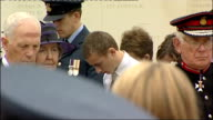 Queen attends service of commemoration at the National Memorial Arboretum Members of the congregation / Queen listening to prayer SOT / Queen...