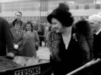 Queen Elizabeth helps to plant a tree at the new Lansbury housing estate in Poplar