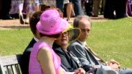 Queen Elizabeth hosts Diamond Jubilee garden party at Sandringham ENGLAND Norfolk Sandringham Estate EXT Various shots of garden party guests in...