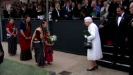 Queen Elizabeth II accepts flowers from a little girl in Nepalese traditional dress and departs Hundreds of Gurkhas have attended an event with the...