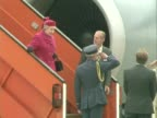 Queen Elizabeth ii and Duke of Edinburgh walk down aircraft steps after visit to Canada Happily chat to group members on the tarmac before walking...