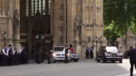 Queen Elizabeth II and Prince Charles leaving the Houses of Parliament after delivering the Queen's speech