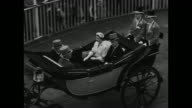 Queen Elizabeth II and Prince Philip Duke of Edinburgh arrive in carriage at the Royal Ascot horse race in Ascot England on 6/18/53 / 6/17/53 WS...