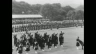 WS Queen Elizabeth II and Prince Philip Duke of Edinburgh on lawn of Holyrood Palace for military review in Edinburgh pan lawn to line of Argyll and...