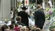 Queen Elizabeth II becomes longest reigning monarch T05099703 Buckingham Palace Queen and Prince Philip looking at flowers laid outside the palace...