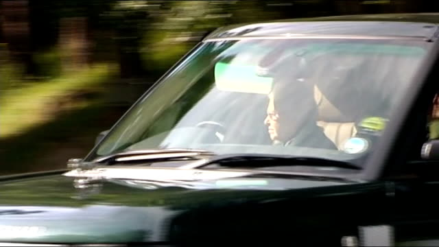 Balmoral EXT Queen Elizabeth II driving Range Rover car and turning right