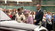 Queen Elizabeth II Duke of Edinburgh Alan Shearer and Duchess of Northumberland at Alnwick Castle Queen smiling / Crowd applauding as Queen Shearer...