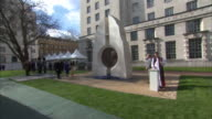 Queen Elizabeth II officially unveiling a monument commemorating servicemen and women killed in Iraq and Afghanistan