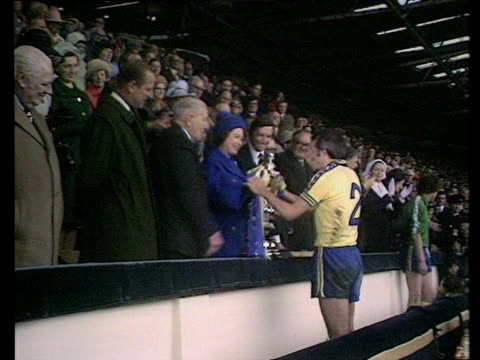 Queen Elizabeth II presents FA Cup trophy to Southampton captain Peter Rodrigues Prince Phillip looks on Southampton vs Manchester United 1976 FA Cup...
