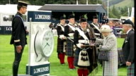 Queen Elizabeth II rounds off historic week with trip to Perthshire Horse Show Shows exterior shots of Queen Elizabeth II arriving with Brigadier...
