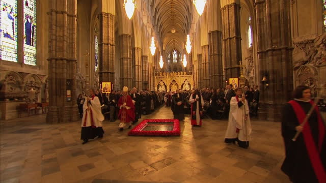 Queen Elizabeth II the Duke Of Edinburgh attend the Tenth General Synod inauguration Shows interior shots the Queen walking through Westminster Abbey...
