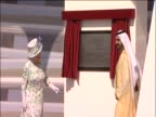 Queen Elizabeth II unveils plaque during a royal visit to Abu Dhabi