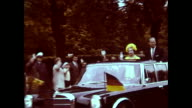 Queen Elizabeth II visiting West Berlin Royal Airforce Gatow policemen with bycicles waiting airplane in the sky traffic policemen gives orders many...