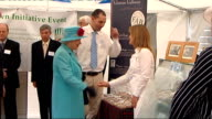 Queen Elizabeth II visits Dumfries Back view of Queen Elizabeth greeting officials at livestock show and making presentation / Various of Queen...