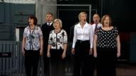 Queen Elizabeth II visits Dumfries Group of people performing song for Queen Elizabeth SOT / Queen Elizabeth and others applauding SOT