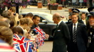 Queen Elizabeth II visits Dumfries Prince Philip chatting to people in crowd / Queen Elizabeth chatting to her Lady in Waiting / Royal maroon Bentley...