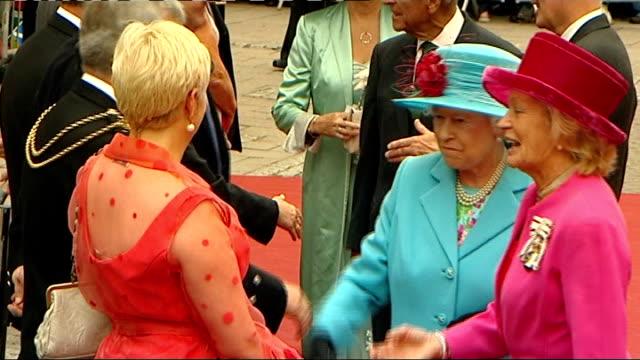Queen Elizabeth II visits Dumfries SCOTLAND Dumfries Midsteeple EXT Royal maroon Bentley State Limousine car arriving in town centre as crowd cheer...