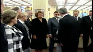 Queen Elizabeth II visits Lithuania / speech to parliament **BEWARE Queen towards into building with unidentified official as applauded SOT / Queen...