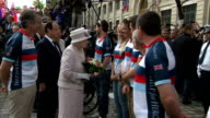 Queen Elizabeth II visits Paris market on trip to commemorate DDay **Music heard intermittently SOT** Queen followed by Hollande and Hidalgo and...