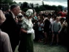 Queen Elizabeth II's Silver Jubilee tour MUSIC NEW ZEALAND Rotorua MS Queen man walk slowly LR past crowds