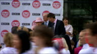 Sport Relief Mile ENGLAND Greater Manchester Salford BBC MediaCityUK EXT Various of Queen Elizabeth accompanied by Prince Philip Duke of Edinburgh...