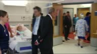 Queen Elizabeth opens new Glasgow hopsital INT Queen along as chatting to man / Queen along chatting to crowd and accepting floral posey / Queen...