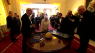 Queen Elizabeth the Sultan of Brunei and Prince Philip being shown war memorabilia Hundreds of Gurkhas have attended an event with the Queen and the...