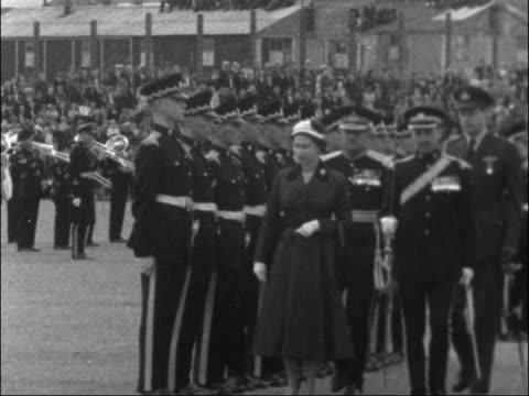 Queen Elizabeth visits Catterick Camp ENGLAND North Yorkshire Catterick Garrison EXT Various shots of Queen Elizabeth intpecting British troops on...