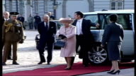 Riga EXT Royal Range Rover car into Presidential Palace courtyard/ Queen Elizabeth ll out of car with Prince Philip and along red carpet/ Vars Queen...