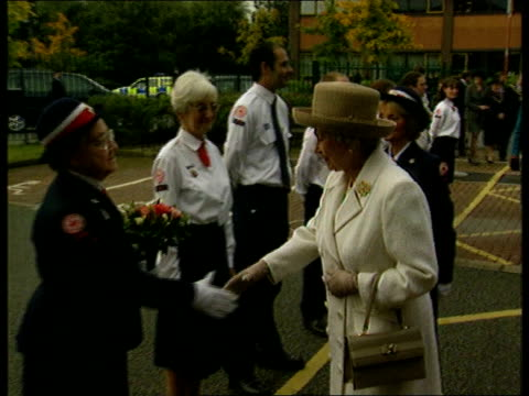 ROYAL / Queen given bouquet of cannabis leaves LIB Manchester Red Cross Centre EXT Queen Elizabeth II along with woman in uniform as receives bouquet...