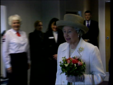 ROYAL / Queen given bouquetof cannabis leaves LIB Manchester Red Cross Centre Queen Elizabeth II along with woman in uniform as receives bouquet of...