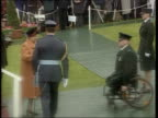 Queen honours RUC officers LTN JO ANDREWS NORTHERN IRELAND Belfast Hillsborough EXT LMS Queen Elizabeth II up steps onto stage followed by Sir Ronnie...