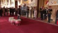 Queen honours The Royal Lancers at Windsor Castle ENGLAND Berkshire Windsor Castle St George's Hall INT Troops marching along / Queen Elizabeth II...