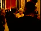 Queen hosts Achievers Reception at Buckingham palace Queen greeting choir singers chatting Prince Philip chatting to choir SOT / Queen meeting man...