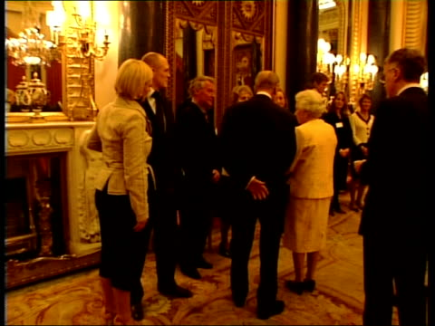 Queen hosts Achievers Reception at Buckingham palace Queen meeting unidentified guests / Zara Phillips chatting to Prince Phillip as Mike Tindall...