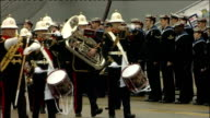 Queen joins HMS Ark Royal's 25th anniversary celebrations inspection of Guard of Honour ENGLAND Hampshire Portsmouth EXT Parade of naval sailors...