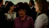 Queen meets New Zealand All Blacks and Prime Minister Queen speaking with unidentfied woman EXT Queen along with Key and others receiving bouquet of...