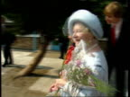 Queen Mother says goodbyes/receives flowers TO