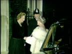Queen Mother at Downing Street NIGHT ENGLAND London No10 MS Out of car greeted by Prime Minister Margaret Thatcher poses and waves SOF of claps CAS...