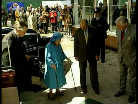 Queen Mother attends Whitbread Gold Cup b1720 U'LAY Sandown Park Queen Mother stepping onto disinfectant mat on arrival at Sandown Park racecourse