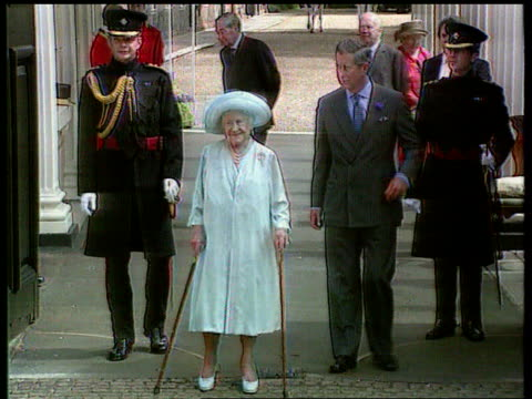 Queen Mother medical records found in street LIB Queen Mother standing with two walking sticks next Prince Charles Prince of Wales during parade past...