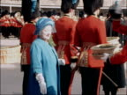 Queen Mother presents shamrocks to Irish Guards on St Patrick's Day ENGLAND Berkshire Windsor Victoria Barracks EXT Close up Queen Mother presents...